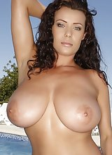 Brunette Elle Faye Big Tits Wet and Oiled at Poolside